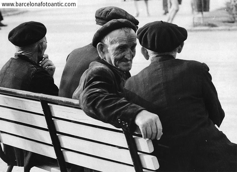 Old men sunbathing on the street